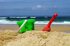 Colorful beach toys on sand. Colorful summer children beach toys on ocean coast in Portugal Royalty Free Stock Photography