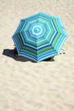 Colorful beach umbrella. With stripes on the beach Stock Photo