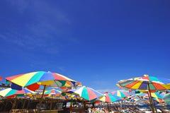 Colorful Beach Umbrella. Beach Chair and Colorful Umbrella on the Beach stock photos