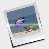 Colorful beach umbrella Stock Images