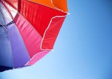 Colorful Beach Umbrella against the Sky Stock Photos