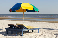 Colorful Beach Umbrella and Lounge Chair Stock Images