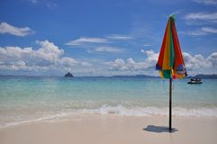 Colorful  beach umbrella. With nice sky Stock Photography