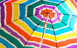 Colorful beach umbrella. Spread out a beach umbrella with color stripes Royalty Free Stock Images