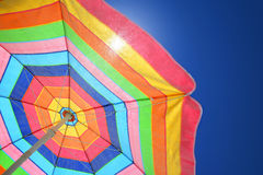 Colorful beach umbrella on a sunny day stock photography