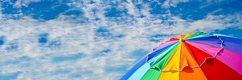 Colorful Beach Umbrella. Top of a Beach Umbrella against the sky. Horizontal size banner with copy space Royalty Free Stock Photography