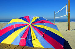 Colorful Beach Umbrella and Volleyball Net Stock Photography