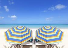 Colorful beach umbrellas. In a Caribbean paradise Stock Photos
