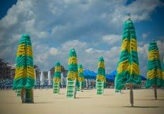 Colorful beach umbrellas on a deserted beach Stock Photos