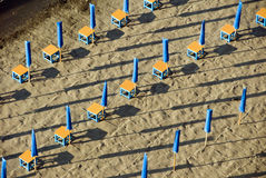 Colorful beach umbrellas in neat rows Royalty Free Stock Photo