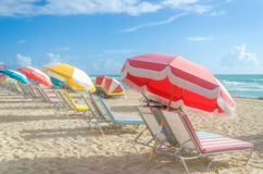 Colorful Beach umbrellas/parasols and cabanas near ocean Royalty Free Stock Images