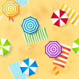 Colorful beach umbrellas and towels at the sand Stock Photo