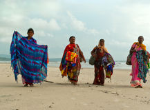 Colorful beach women sellers. Goa Stock Images