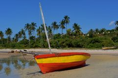 Beached Fishing Boat, Vilanculos. Colorful beached Fishing Boat (Dhow) in Vilanculos during low tide in Mozambique stock photo