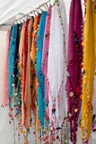 Colorful Beaded Scarves Hang In Vendor Booth At Festival Stock Images