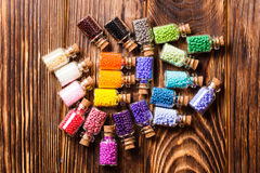 Colorful beads in the bottles Stock Image