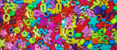 Colorful craft beads, numbers and letters Stock Images