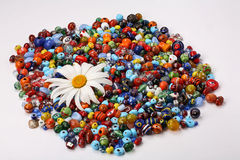 Colorful beads and daisy Stock Photo