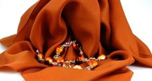 Colorful beads draped white Stock Photo