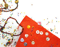Colorful beads and fabric background Royalty Free Stock Image