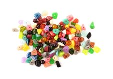 Colorful beads. Glass, seed beads and felted beads for jewelry making on white background. Hobby, handmade, fine arts royalty free stock images