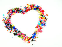 Colorful beads heart shape space for photo or text Royalty Free Stock Photography