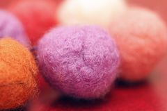 Colorful beads made of felt closeup. Macro photo on a red background Royalty Free Stock Photography