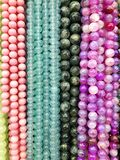 Colorful beads made of natural stones royalty free stock photography