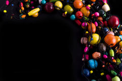 Colorful beads necklace frame on black Stock Photo