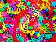 Colorful beads, numbers and letters Royalty Free Stock Image