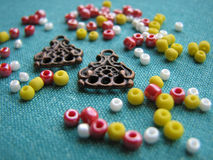 Colorful beads and pieces of earrings, handmade jewelry Stock Image
