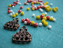 Colorful beads and pieces of earrings, handmade jewelry Stock Photos
