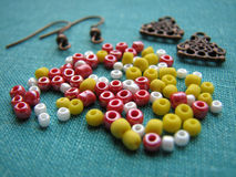 Colorful beads and pieces for making earrings, handmade jewelry Stock Image