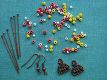 Colorful beads and pieces for making earrings, handmade jewelry Stock Images