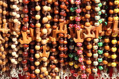 Colorful beads with tau cross Royalty Free Stock Images