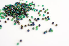 Colorful beads on a white background Stock Photos