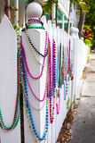 Colorful beads on a white fence Stock Image