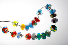 Colorful beads on wire. Colorful glass beads on a wire Stock Photography