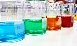 Colorful Beakers. Beakers from experimentation in Physical Chemistry Lab Stock Photos
