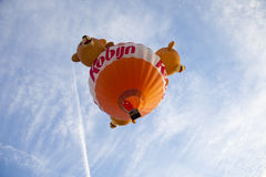 Colorful bear balloon taking off Royalty Free Stock Photo