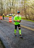 Colorful and Bearded Runner Competing  - 2019 Blue Ridge Marathon. Roanoke County, VA – April 13th: A very colorful and bearded runner, competing in the royalty free stock images