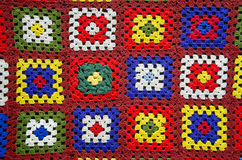 Colorful beautiful handmade knitted tablecloth background Royalty Free Stock Image