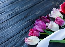 Free Colorful Beautiful Pink Violet Tulips On Gray Wooden Table. Valentines, Spring Background. Floral Mock Up. With Copyspace. Royalty Free Stock Photos - 133183738