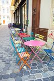 Summer empty open air restaraunt in european city. Colorful beautiful summer empty open air cafe in Vienna. Ice-cream cafe royalty free stock photography