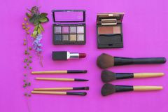 Colorful beauty skin face cosmetics makeup collection for lifestyle woman. On background pink royalty free stock images