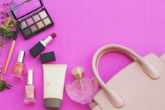 Colorful beauty skin face cosmetics makeup collection for lifestyle woman. On background pink royalty free stock photo