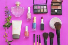 Colorful beauty skin face cosmetics makeup collection for lifestyle woman. On background pink stock images