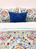 Colorful bed linen with floral design Stock Photography
