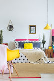 Colorful bed and mexican accents. Colorful bed, mexican accents, yellow accessories and modern furniture Stock Images