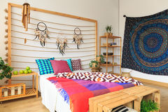 Colorful bedroom in ethnic style Stock Photography